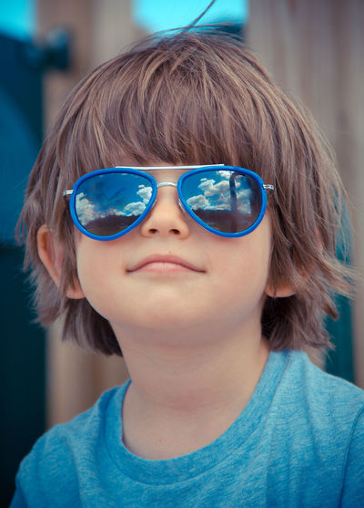 Fashion Portrait Of A Woman Reflection Tshirt Blue Boy Childhood Close-up Clouds Day Eyeglasses  Focus On Foreground Front View Indoors  Looking At Camera One Person Playground Portrait Real People Sky Smiling Smiling Face Sun Glasses Sunglasses Fashion Stories Go Higher