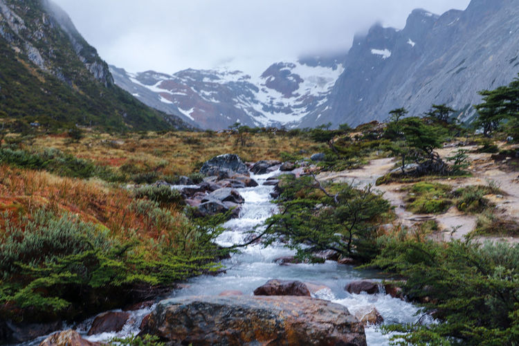 Steam from the Lake - Laguna Esmerelda, Argentina Rain Stream Rock Travel Photography EyeEmNewHere Laguna Esmeralda Ushuaia Argentina Mountain Snow Landscape Mountain Range Snowcapped Mountain Nature Travel Destinations No People Outdoors Scenics Beauty In Nature Water Summer