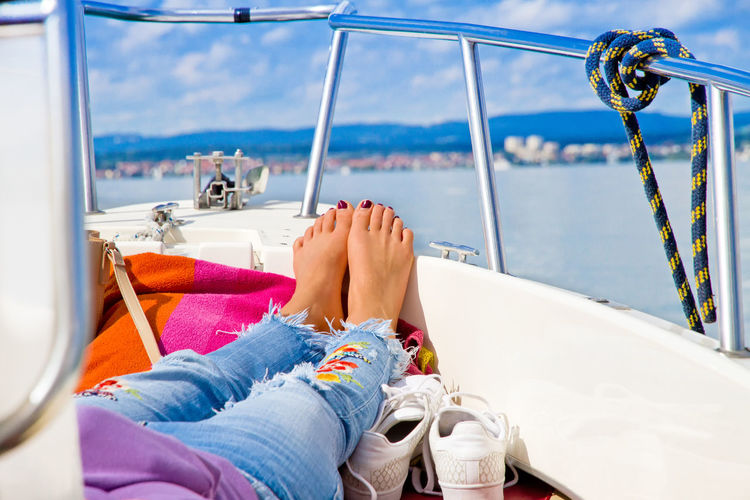 Girl enjoy the sun and relaxing on boat Baden-Württemberg  Happy Lake Constance Woman barefoot Boat Bodensee Germany Girl Health Lake Legs Leisure Activity Lifestyles Lying Down Nautical Vessel People Relax Relaxation Sailing Sea Silence Sky Vacations Water