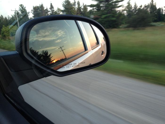 Reflection of electric pole on side-view mirror