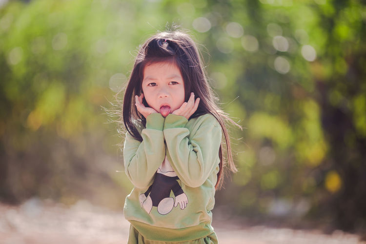 Young girl is lovely Young Girl EyeEm Best Shots EyeEm Selects Beautiful Girl Beautiful Woman Children Only Child One Girl Only Childhood One Person Girls People Portrait Smiling Motion Close-up Human Body Part Nature Focus On Foreground Outdoors Day Looking At Camera Standing