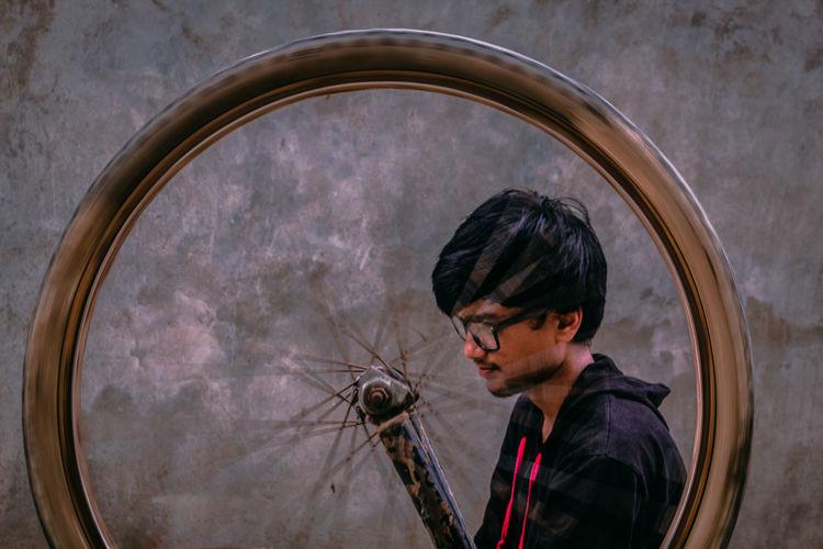 Young man repairing bicycle