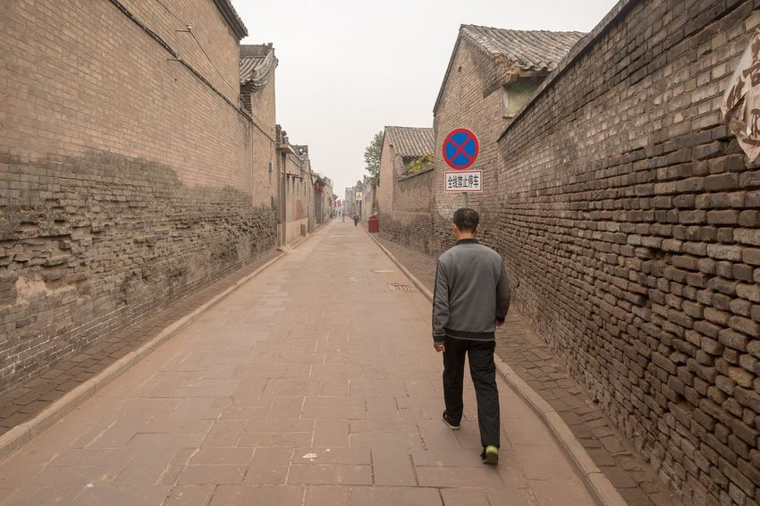 Walking the ancient city of Pingyao Shanxi China Travel China People Documentary Storytelling EyeEm Selects Rear View Architecture Full Length Real People Lifestyles Built Structure City The Past