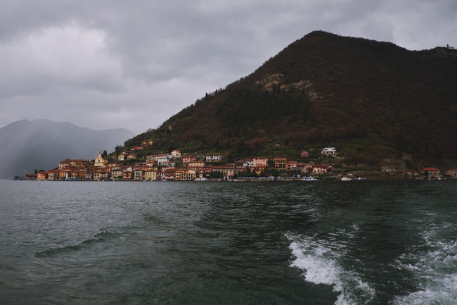 Leaving Monte Isola on the ferry. Ferry Lake Iseo (italy) Monte Isola Rain Water Reflections Beauty In Nature Cloud - Sky Gloomy Day Island Isle Italy Italy❤️ Italy🇮🇹 Lake Lake Iseo Lake View Mountain Nature No People Outdoors Scenics - Nature Sea Sky Water Waterfront