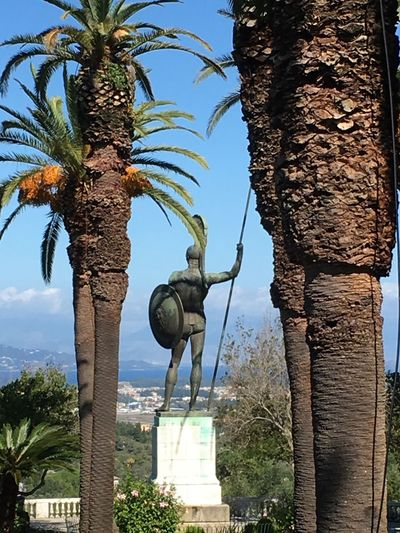 Achilles Statue Achilleion Palace Garden Statue Palm Trees Statue of The winning Achilles Loopings down towards the city of Kerkyra, Greece