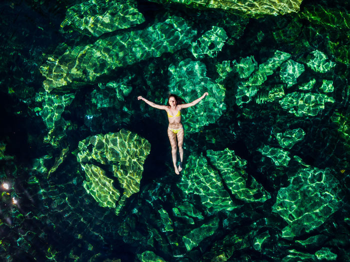 Directly above shot of woman swimming in sea
