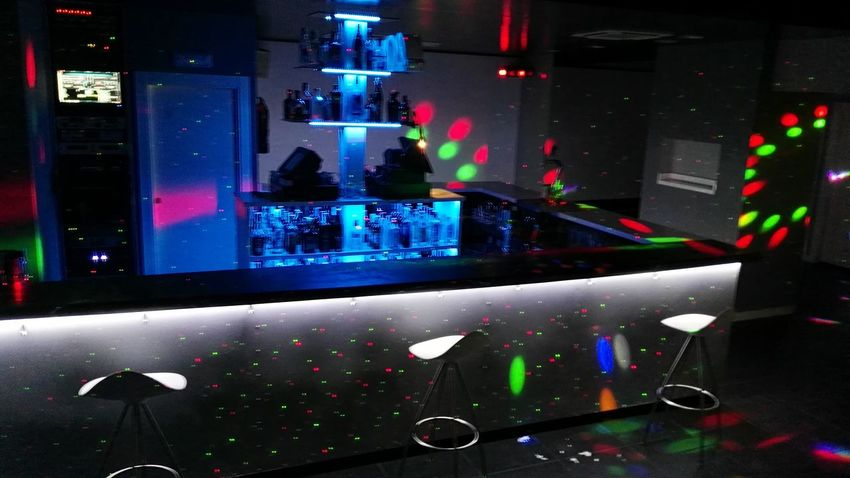 Indoors  Night Glass Nightclub Bar - Drink Establishment Nightlife Stage - Performance Space Large Group Of Objects Hobbies Multi Colored