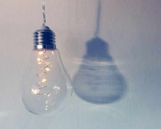 Hanging lightbulb Indoors  Light Bulb No People Close-up Shadow Filament LED Led Lights  Vintage Edison Bulb Wall Light And Shadow Illuminated