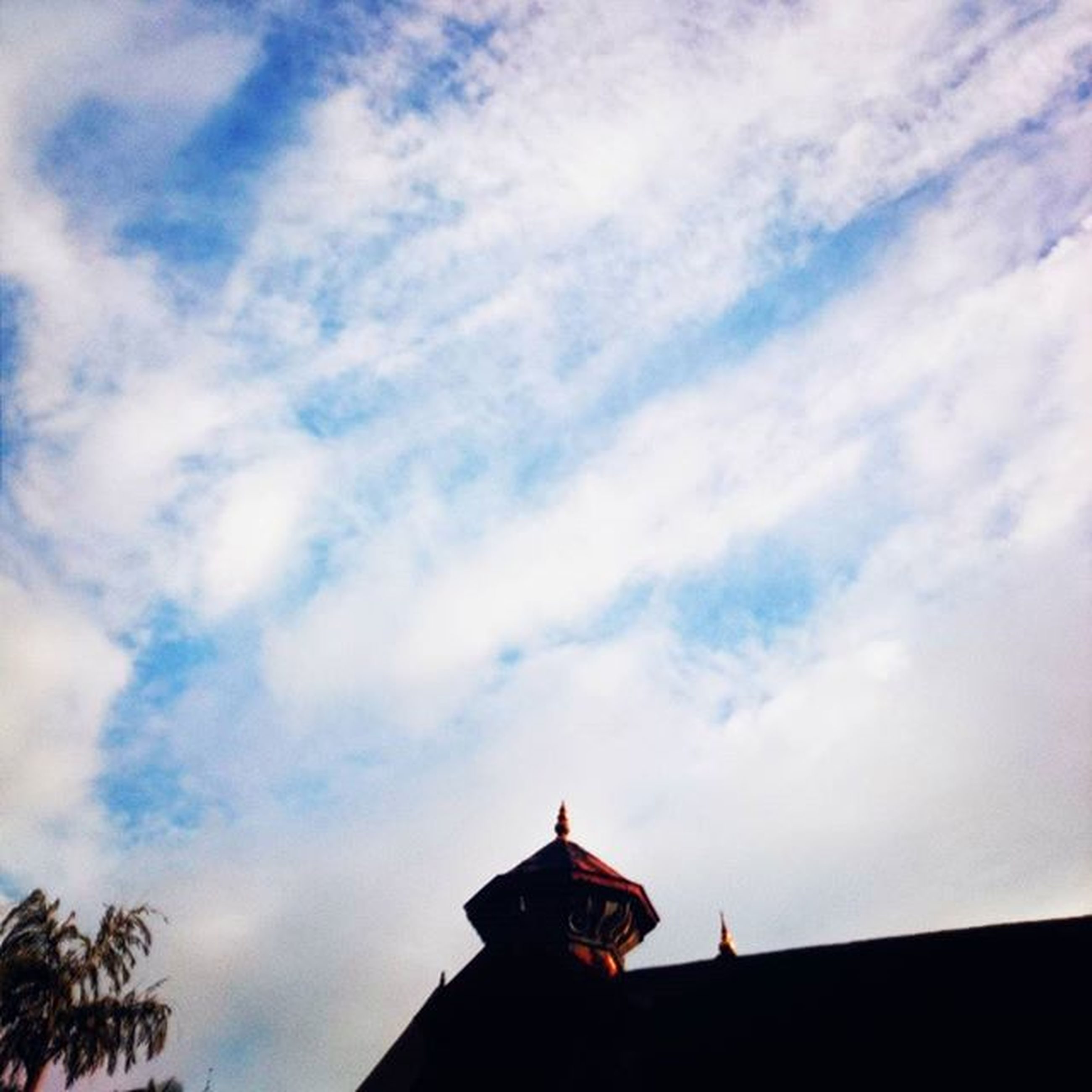 low angle view, sky, architecture, built structure, building exterior, cloud - sky, high section, cloudy, cloud, roof, outdoors, no people, weather, house, day, nature, place of worship, silhouette, religion, overcast