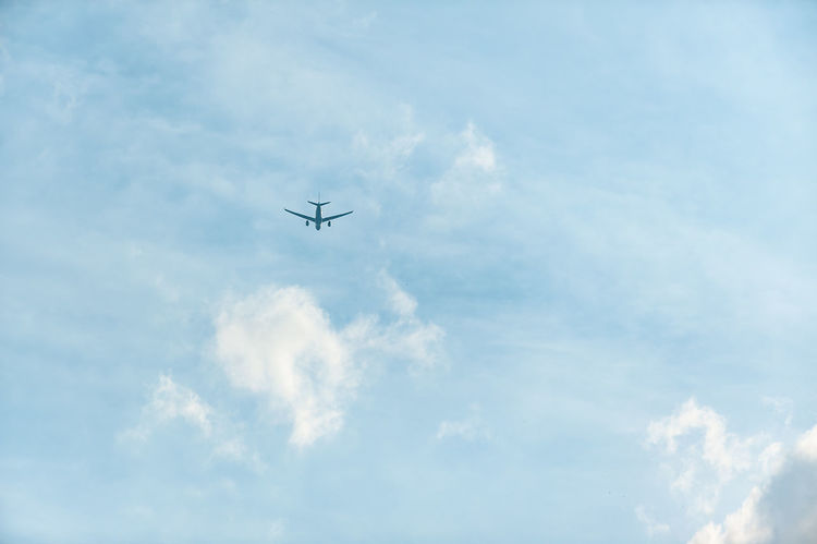 Holidays Wanderlust Aerospace Industry Air Vehicle Airplane Blue Cloud - Sky Day Destination Flying Future Low Angle View Mid-air Mode Of Transportation Motion Nature No People on the move Outdoors Plane Public Transportation Sky Tourism Transportation Travel