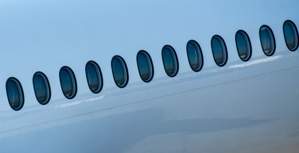Gate Business Window Windows Traveling Travel Airport Aeroplane Aerospace Industry Airplane No People Blue Side By Side Low Angle View In A Row Close-up Shape Copy Space White Color Repetition Pattern Built Structure