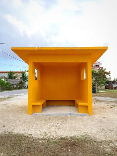 Yellow built structure against sky