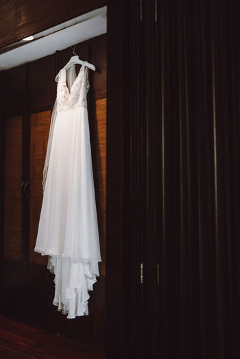 Low angle view of wedding dress hanging on closet