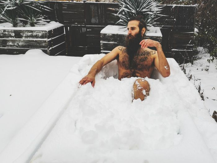 Spa relaxing in a bath with snow Arttyshenko Bath Man Beardman Guy Snow New Year Cristmas Yoga Cold Temperature Torso Nude_body EyeEmNewHere Cold Temperature Beauty Winter Full Length Snow Shirtless Portrait Relaxation Fitness