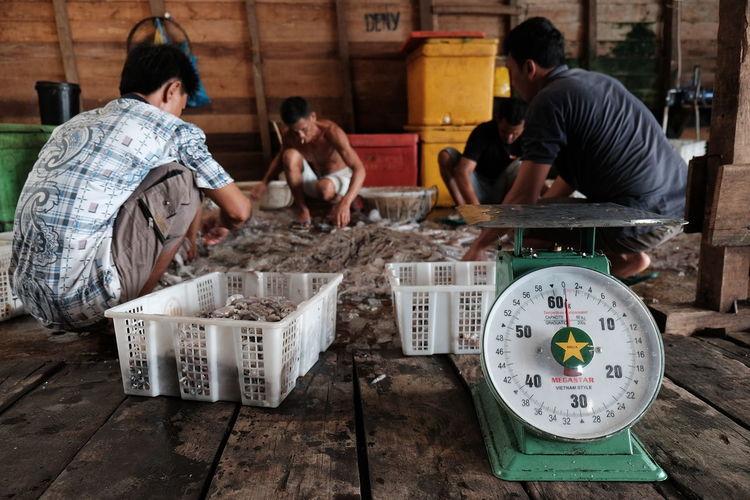 Men working at fishing market