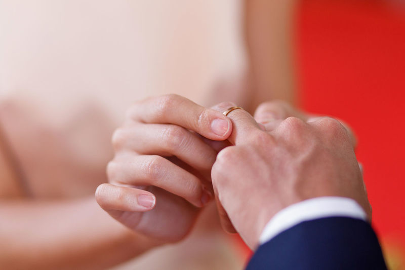 The bride places the wedding ring on the groom's finger Hand Human Hand Human Body Part Adult Ring Jewelry Togetherness Body Part Men Love Holding Women Close-up People Two People Positive Emotion Focus On Foreground Emotion Wedding Ring Males  Finger Care Luxury Bride And Groom Wedding Ceremony