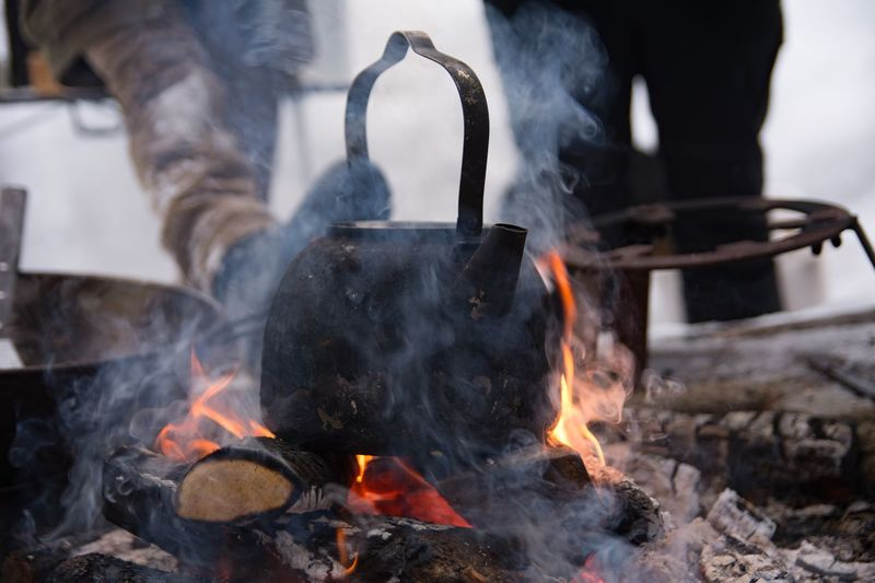 Close-Up Of Tea Kettle On Bonfire In Forest