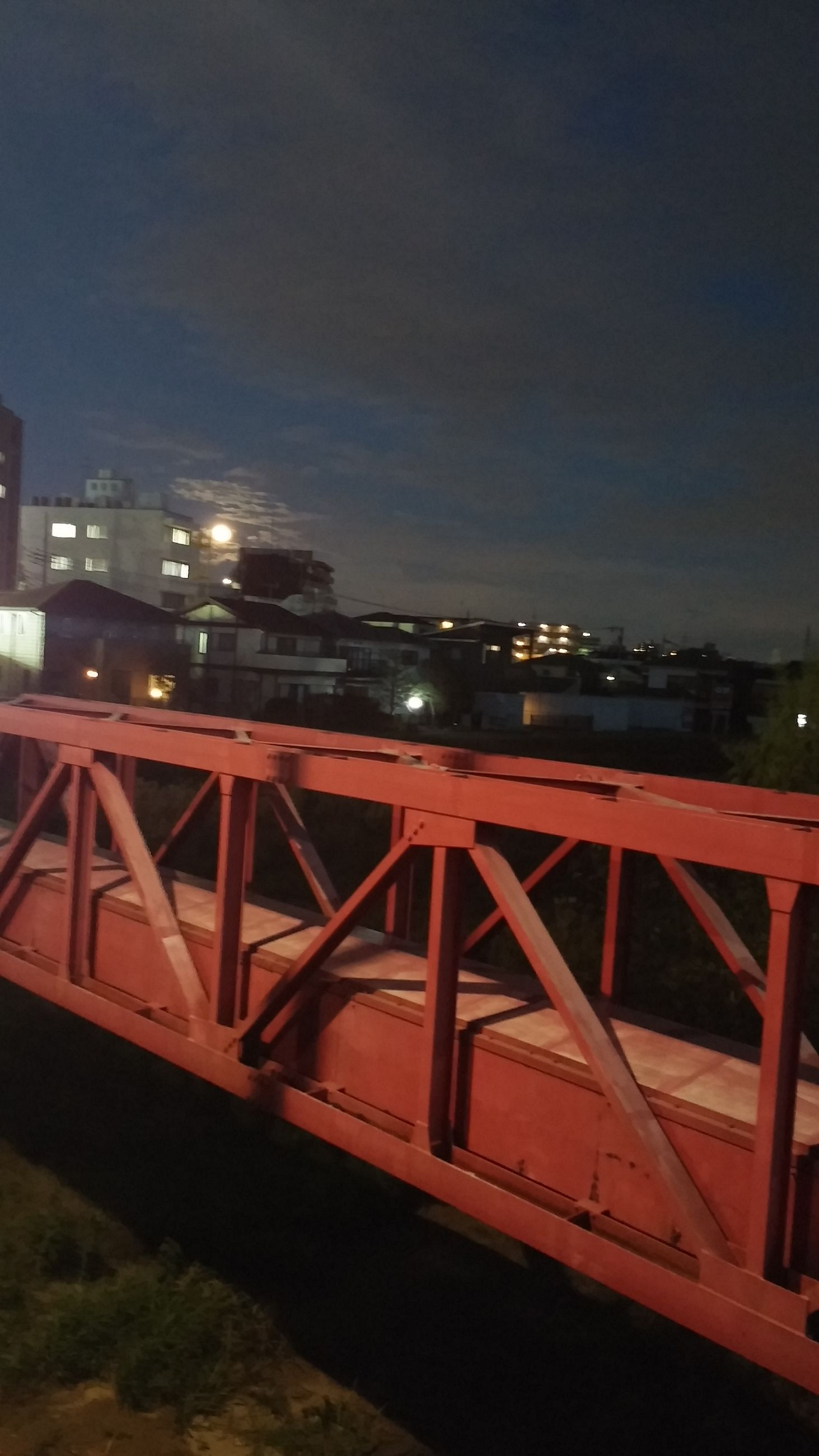 illuminated, night, built structure, low angle view, architecture, connection, engineering, industry, metal, bridge - man made structure, sky, transportation, no people, outdoors, red, clear sky, development, light - natural phenomenon, lighting equipment, dusk