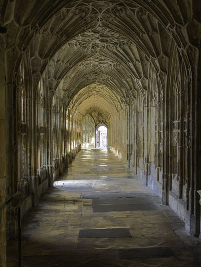 Cloisters  Architecture Arch The Way Forward Religion Built Structure Indoors  Corridor Place Of Worship Spirituality Light At The End Of The Tunnel Architectural Column Cathedral Gloucester Cathedral