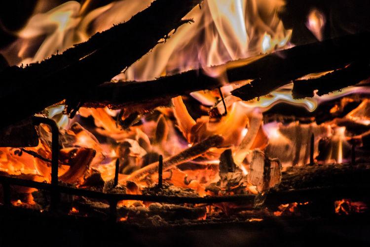Lit bonfire at night