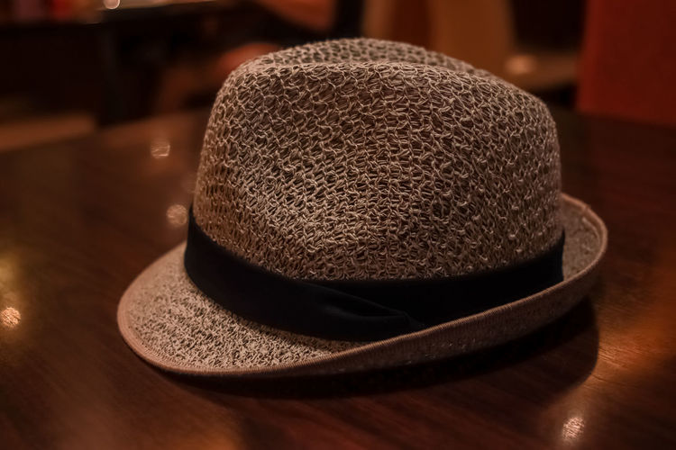 Hat on the Table Hat Wood - Material Table Indoors  Close-up Clothing No People Pattern Personal Accessory Still Life Brown Fashion Focus On Foreground Headwear Textured  Food And Drink