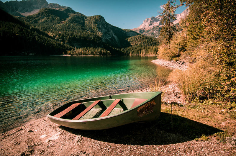 Bear on boat. Nautical Vessel Transportation Boat Water Lake Tranquil Scene Tranquility Mountain Scenics Reflection Mountain Range Nature Non-urban Scene Outdoors Day Vacations Dolomites, Italy Dolomiti Italy Brenta Dolomites Majestic Landscape Remote