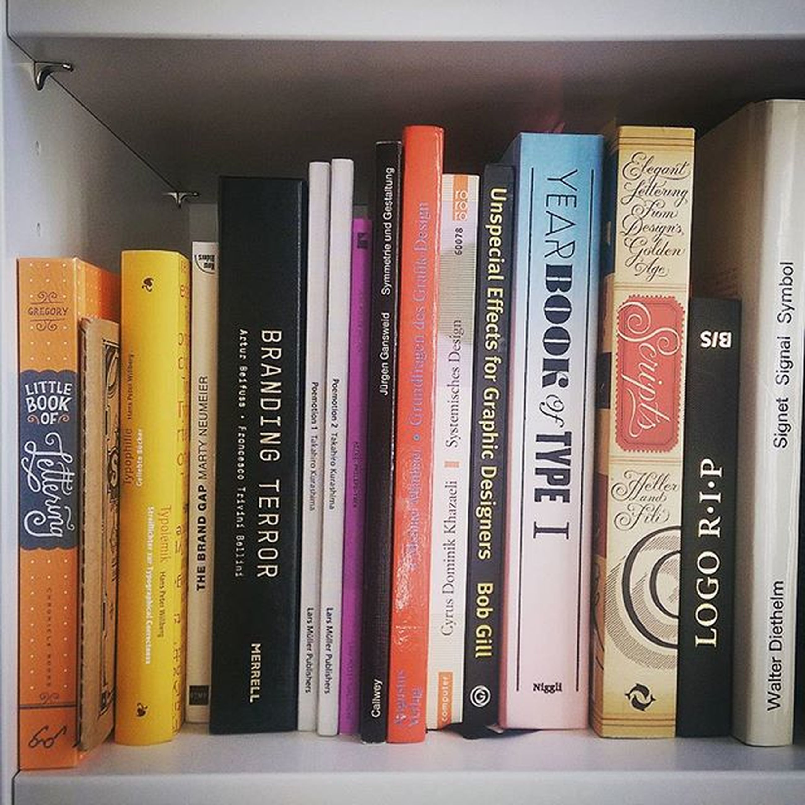 indoors, text, communication, variation, western script, education, book, large group of objects, shelf, choice, still life, in a row, literature, close-up, number, arrangement, no people, order, abundance, stack