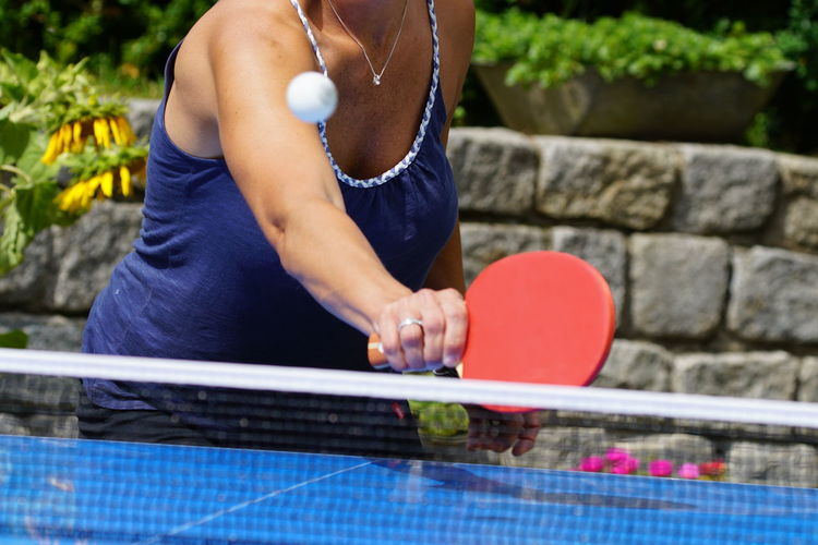 Sport Table Tennis One Person Lifestyles Adult Midsection Playing Leisure Activity Day Holding Casual Clothing Skill  Competition Real People Healthy Lifestyle Preparation  Focus On Foreground Women Nature Outdoors