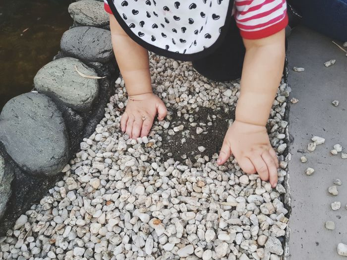 Baby Arm Baby Babyboy Bib Pebble Pebbles Playing Stone Stones Sand Low Section Child One Person Childhood Day Human Body Part Children Only Outdoors People