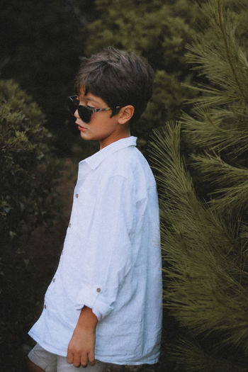 Side view of boy looking at camera