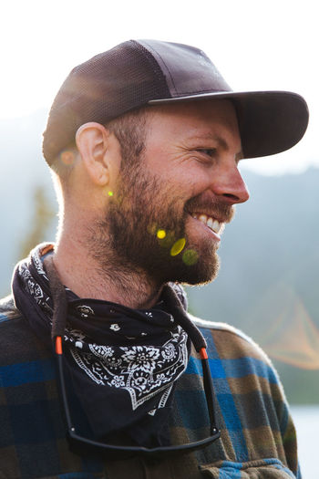 Beard Facial Hair Adult Clothing Hat One Person Men Headshot Portrait Mid Adult Young Adult Leisure Activity Mid Adult Men Smiling Day Casual Clothing Focus On Foreground Looking Away Mustache Outdoors