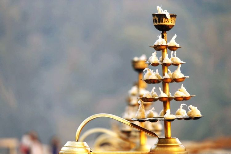Close-up of diyas in stand