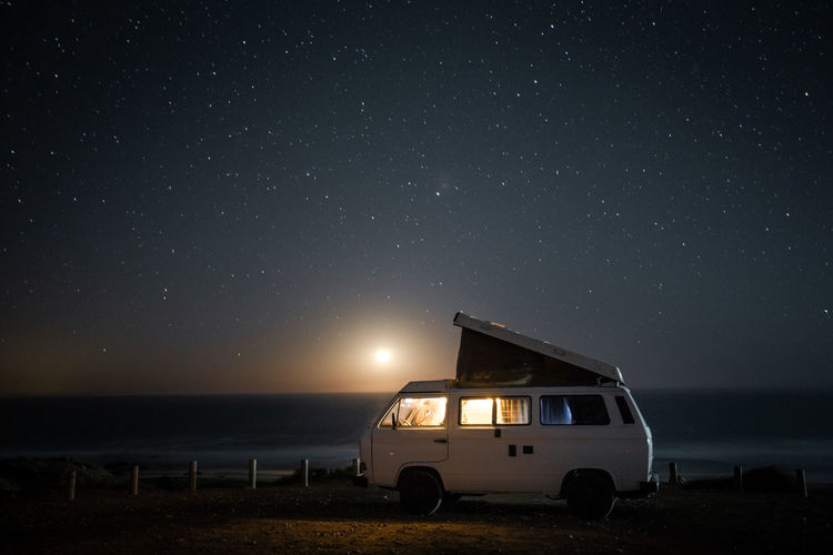 Volkswagen T3 Westfalia camper van under a starry sky on a clear night in Fuerteventura and the setting moon in the background. Night Sky Star - Space Land Nature Scenics - Nature Beach Mode Of Transportation Transportation Sea No People Astronomy Land Vehicle Space Beauty In Nature Horizon Star Field Water Galaxy Outdoors Horizon Over Water Vanlife Vanlifers Vanlifediaries Vanlifeexplorers Vanliving Camper Campervan Camper Van Travel Travel Destinations Traveling Travel Photography Travelling Moon Moonlight Starry Starry Sky Stars Moon Shots Long Exposure Vwbulli Volkswagen VwT3 Vintage Vintage Car Nature Nature_collection Nature Photography Summer