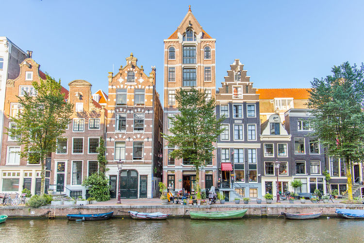 Amsterdam Netherlands Apartment Architecture Building Building Exterior Built Structure Canal Canal Houses City Day Dutch Architecture Dutch Houses Holland Mode Of Transportation Nature Nautical Vessel No People Plant Residential District Row House Singel Sky Transportation Tree Water Waterfront