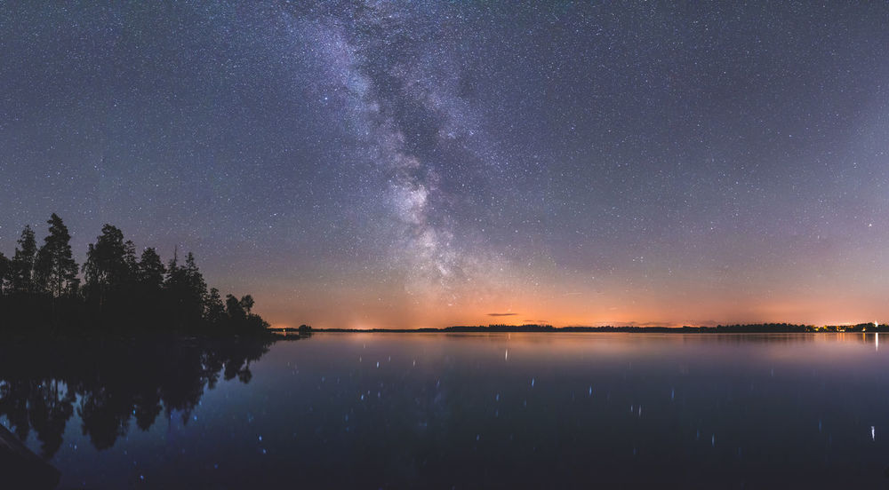 Eternal. Panorama Sweden Astronomy Beauty In Nature Constellation Galaxy Milky Way Nature Night No People Outdoors Reflection Scenics Sky Space Star - Space Star Field Starry Sweden Nature Tranquil Scene Tranquility Tree Water