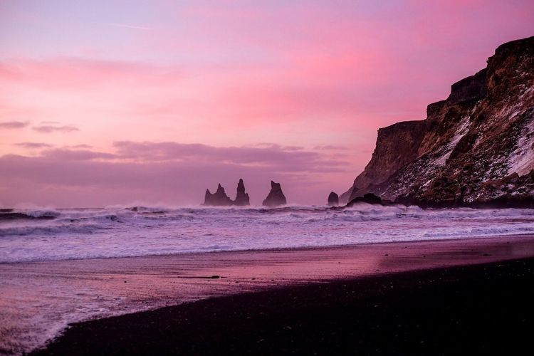 Another Side of Black Sand beach, Iceland EyeEmNewHere EyeEm Nature Lover EyeEm Best Shots Rosy Beachphotography Beach Iceland Black Sand Beach Black Sand Sea Beach Rock - Object Sand Sunset Pink Color Scenics Rock Formation Water Beauty In Nature Sky Nature Horizon Over Water Purple Outdoors No People Cloud - Sky Travel Destinations Tranquility Wave
