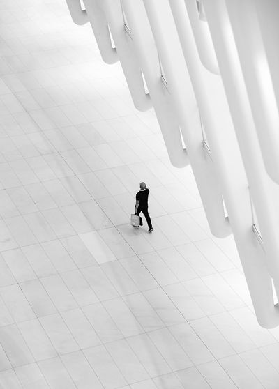 - Moments at the Oculus (2) Blackandwhite Photography EyeEm Best Shots - Black + White Composition Travcimages Streetphotography Eye4photography  FUJIFILM X-T2 eyeemphoto EyeEm Gallery EyeEm Best Shots Nycphotographer One Person Real People Walking High Angle View The Street Photographer - 2018 EyeEm Awards