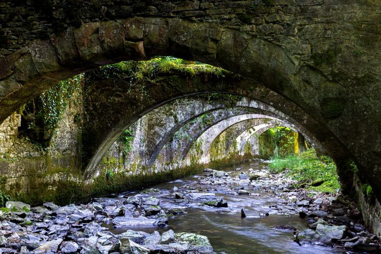 Arch bridge over river stream