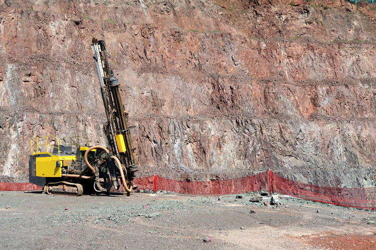 drill machine in a quarry mine. Day Drill Driller Drilling Mining Mining Heritage Mining Industry Mode Of Transport Open Pit Mine Open Pit Mining Outdoors Parked Parking Stationary Surface Mine Surface Mining