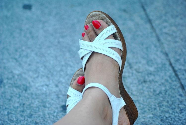 Close-up Of Human Toes With Nail Varnish