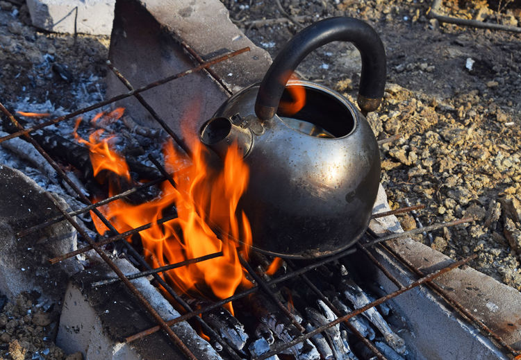High angle view of teakettle on fire