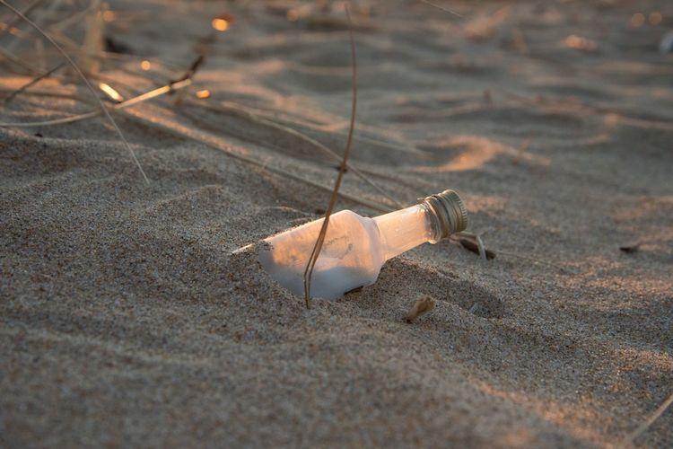 Bottle on sandy beach
