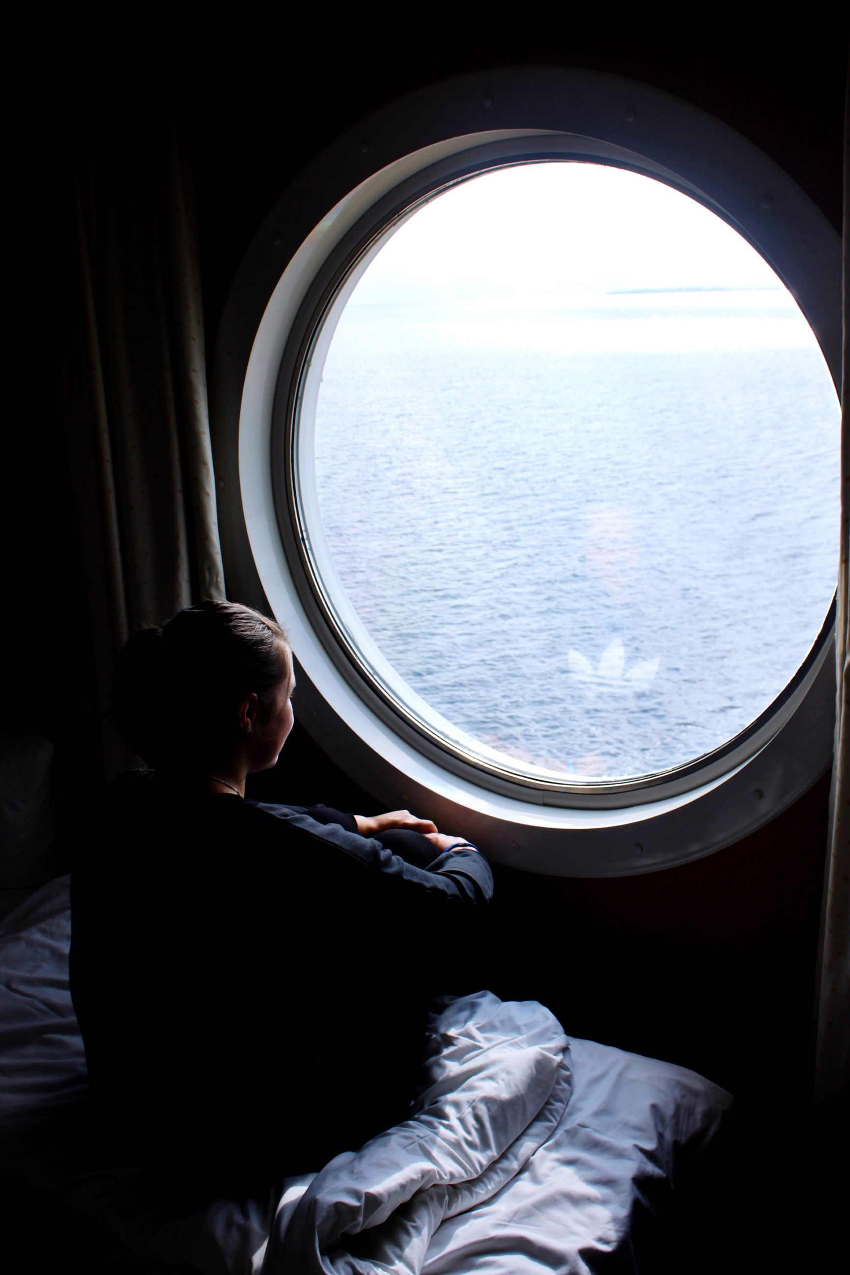 sea, window, water, sitting, indoors, rear view, full length, vacations, journey, day, tourism