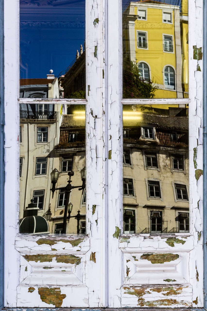 building exterior, architecture, built structure, window, snow, outdoors, winter, day, no people, cold temperature, city, nature
