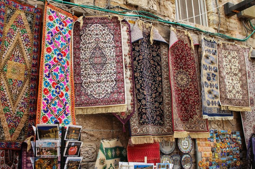 Middle East Muslim Quarter Arabic Buy Carpet Choice Day For Sale Hanging Historic Indoors  Israel Jerusalem Market Multi Colored Muslim No People Retail  Sales Small Business Souvenir Textile Tourism Trade Variation