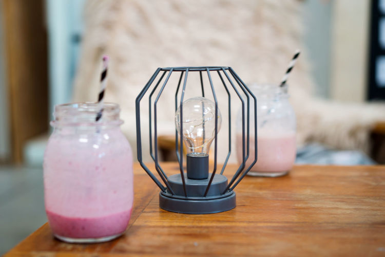 Pink smoothie on the wooden cozy table