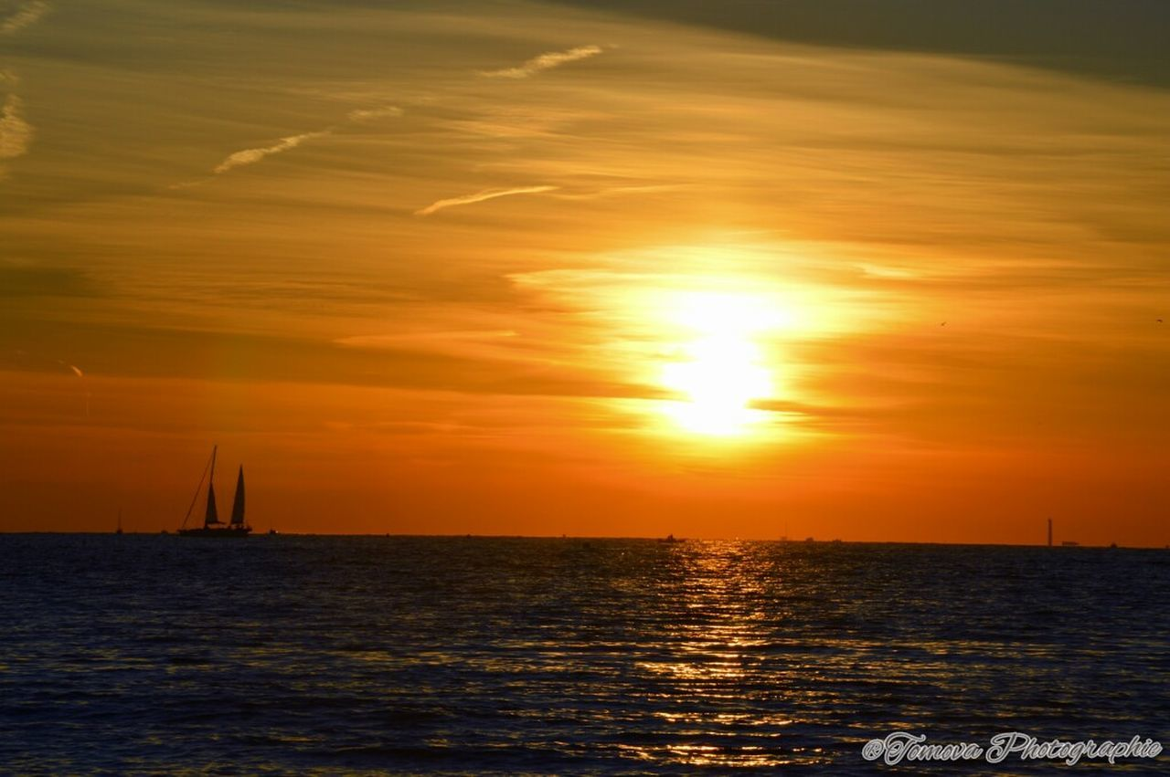 sunset, sea, water, orange color, beauty in nature, sun, scenics, sky, nature, tranquility, waterfront, tranquil scene, no people, nautical vessel, sunlight, horizon over water, silhouette, outdoors, cloud - sky, sailboat, sailing, yacht