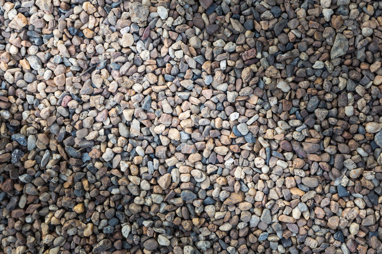 Stone pebbles texture or stone pebbles background. stone pebbles for interior exterior decoration and industrial construction concept design. stone pebbles motifs that occurs natural. Dark Natural Rock Wall Abstract Abundance Background Backgrounds Beach Black Close-up Closeup Day Directly Above Floor Full Frame Granite Grey Large Group Of Objects Marble Material Nature No People Nobody Outdoors Pattern Pebble Pebble Beach Pebbles Rough Row Sand Slate Stone Surface Texture Textured  Tile