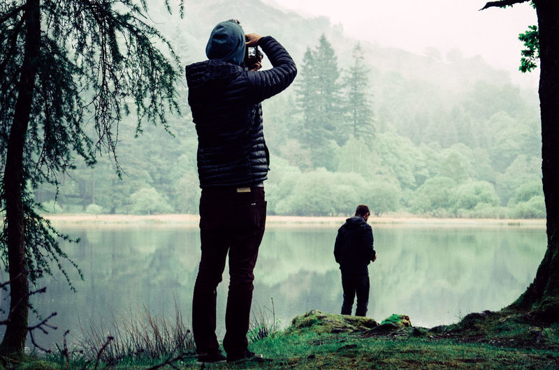 Man Photographing In Forest