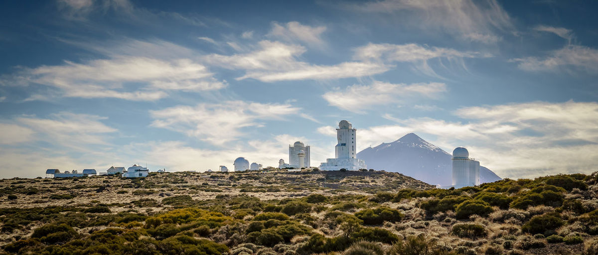 Observatorio del Teide Teide Observatory (Spanish: Observatorio del Teide), IAU code 954, is an astronomical observatory on Mount Teide at 2,390 metres (7,840 ft), located on Tenerife, Spain. It is operated by the Instituto de Astrofísica de Canarias since its inauguration in 1964. It became one of the first major international observatories, attracting telescopes from different countries around the world because of the good astronomical seeing conditions. Later the emphasis for optical telescopes shifted more towards Roque de los Muchachos Observatory on La Palma. (wikipedia) EyeEm Best Shots EyeEmNewHere Observatory SPAIN Teide National Park Teide Volcano Architecture Beauty In Nature Building Building Exterior Built Structure Cloud - Sky Day Environment Island Land Landscape Mountain No People Sky Teide Telescope Tenerife Travel Destinations